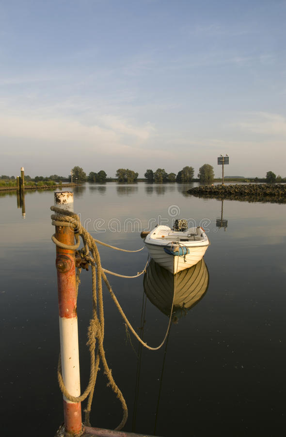 Moored boat in the river Merwede. Near the Peulenlock in Hardinxveld-Giessendam royalty free stock image