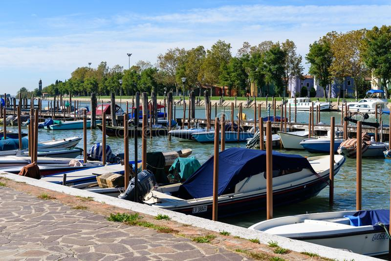 Moored fishing and transport boats , Burano island, Italy royalty free stock image