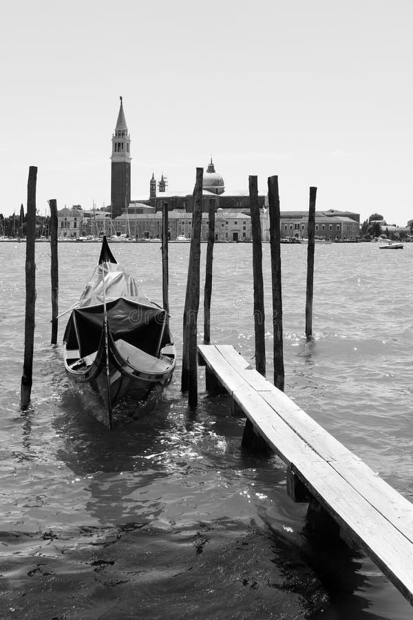 Moored gondola and San Giorgio di Maggiore church in Venice stock images
