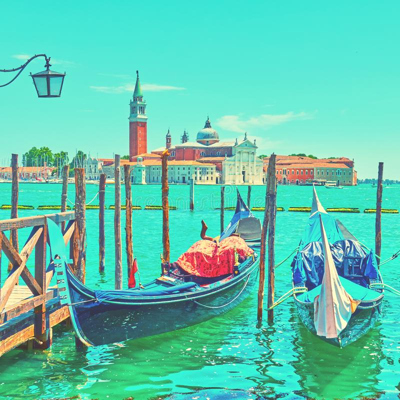 Summer in Venice. Moored gondolas and San Giorgio di Maggiore church in Venice, Italy stock photo