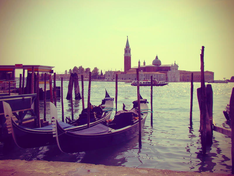Moored gondolas in Venice, vintage toned royalty free stock images