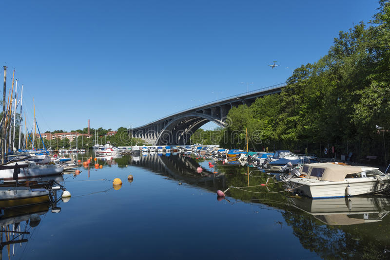 Moored leisureboats calm summer morning Stockholm. Moored leisureboats in marina a calm summer morning at Fredhall (Swedish: Fredhäll) in Stockholm, Sweden stock photo