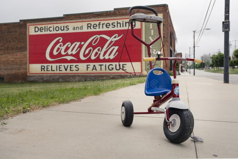 MOORESVILLE, NC-May 19, 2018: Coca Cola Mural Livery Building Radio Flyer Stoller royalty free stock images