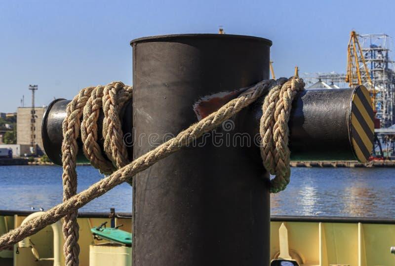 Mooring bollard with ropes stock image