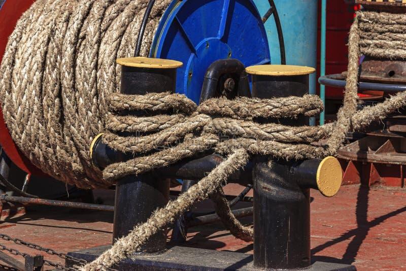 Mooring bollard with ropes stock photos