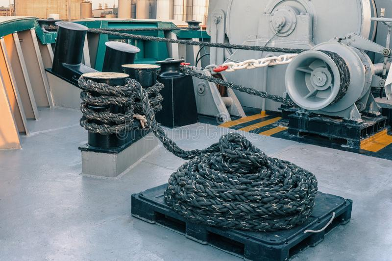 Mooring equipment of ship. Mooring lines are fast on bollards, capstan and winch royalty free stock photos
