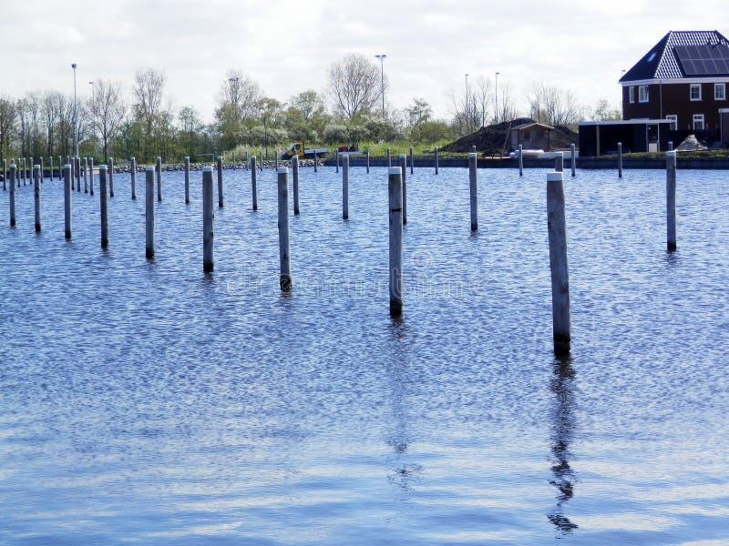 Mooring posts in inner harbor royalty free stock photos