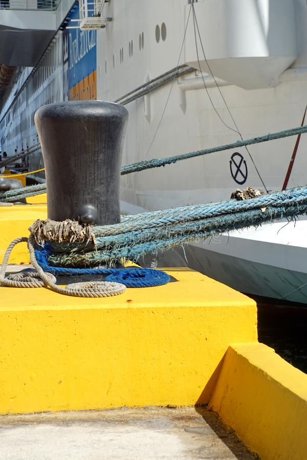 Mooring rope on a bollard on a pier stock image
