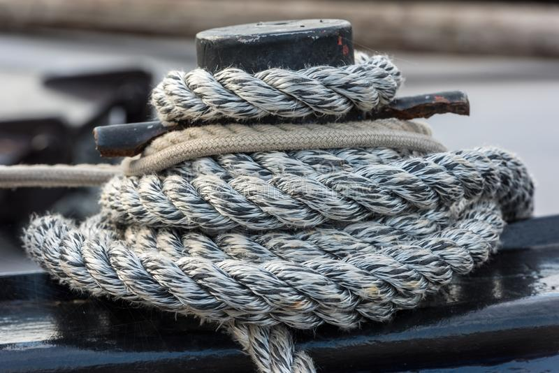 Mooring rope tied around a cleat stock image