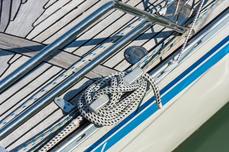 Mooring rope tied around a cleat royalty free stock photo