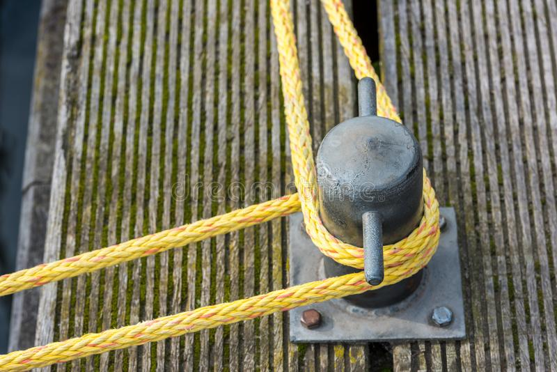 Mooring rope tied around a cleat stock images