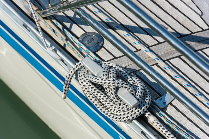 Mooring rope tied around a cleat stock photo