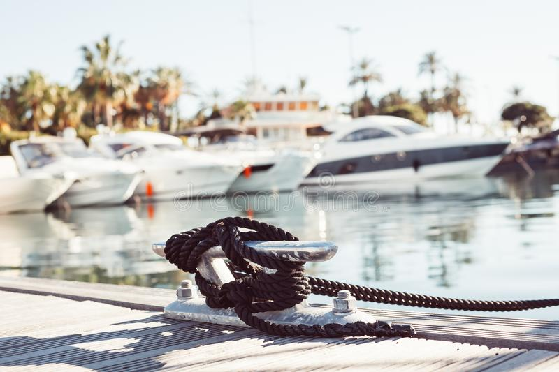 Mooring yacht rope tied around a cleat royalty free stock image
