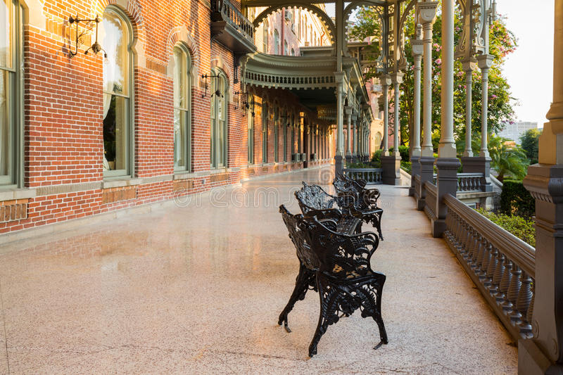 Moorish Architecture of University of Tampa. Cast iron chairs on the marble patio or balcony of Henry B Plant museum is moorish inspired architecture part of the stock photography