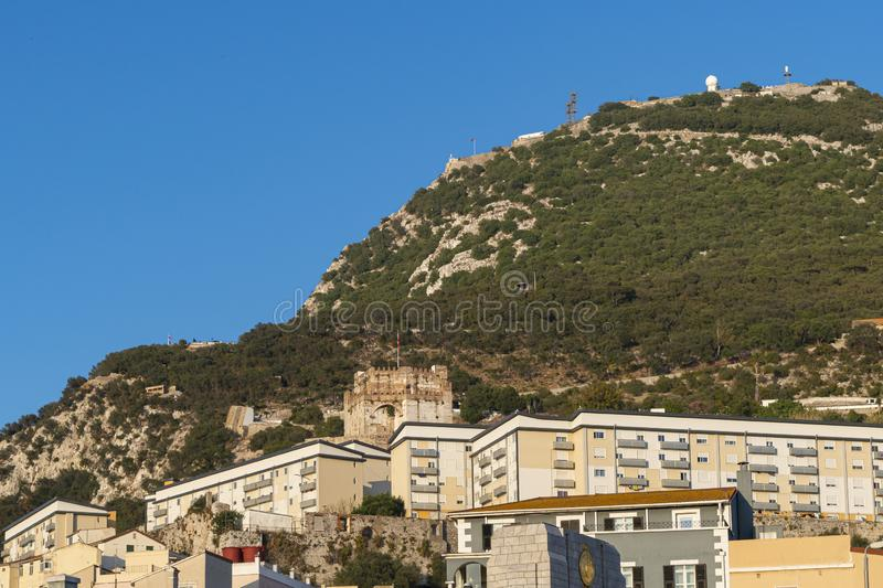 Moorish Castle tower and modern residential buildings Gibraltar. Moorish Castle tower and modern residential buildings in Gibraltar, Europe. Upper rock in the royalty free stock photo