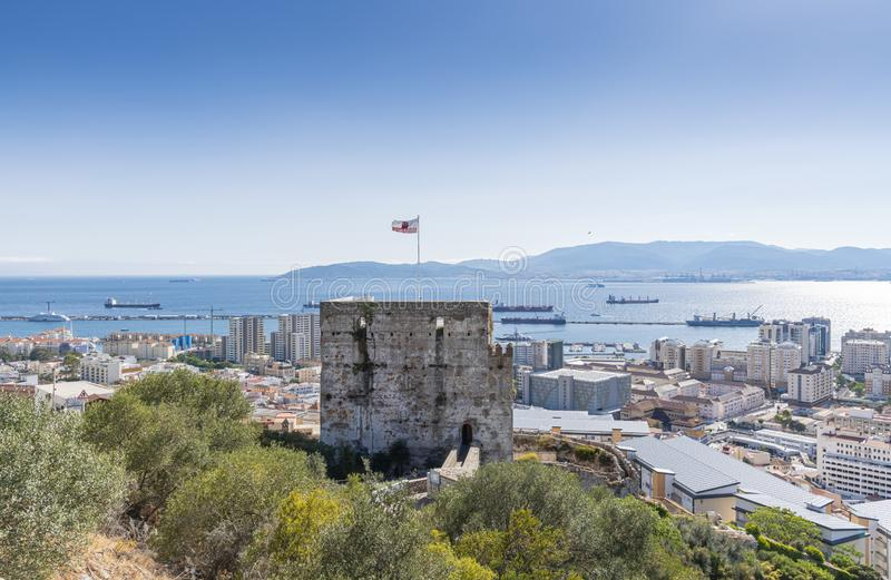 Moorish Castle tower view from the rock of Gibraltar. Europe. In the background Bay of Gibraltar and the city stock image
