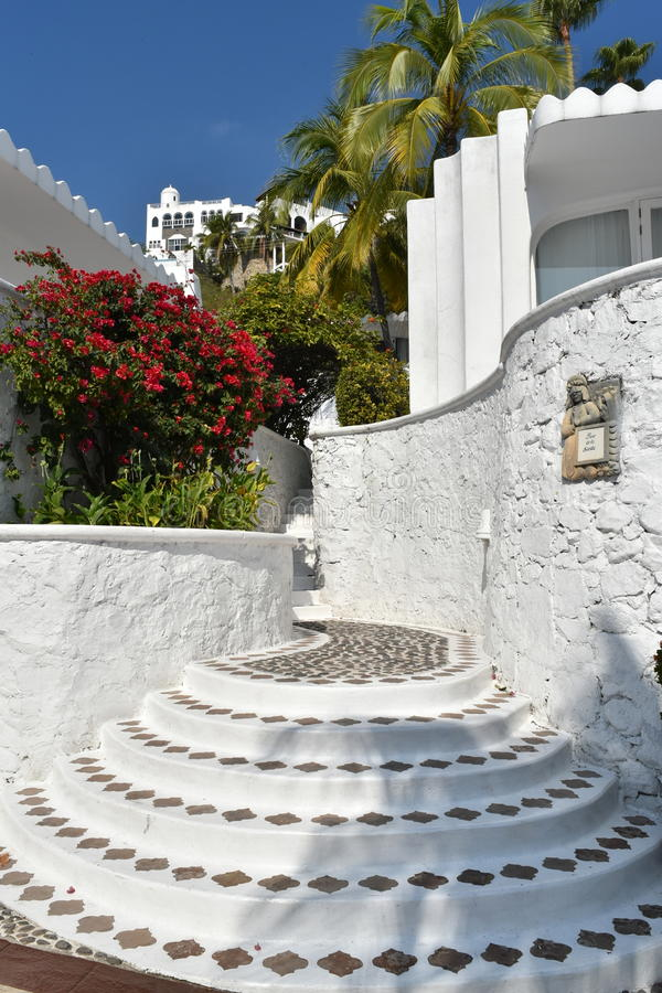 Moorish style stairs. Moorish style architecture and cobblestone streets with plazas and fountains is a hallmark of Las Hadas Resort in Manzanillo, Colima stock images