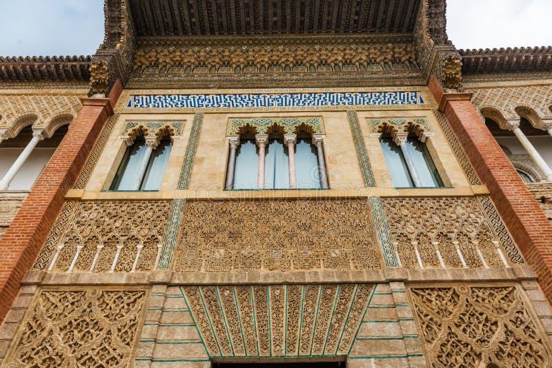 Moorish windows in Patio de la Monteria courtyard royalty free stock photography