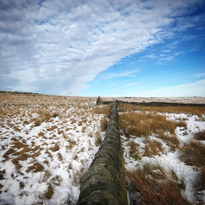 Moorland wall cutting through the landscape stock photos
