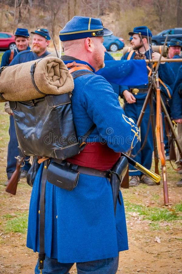 MOORPARK, USA - APRIL, 18, 2018: Unidentified man wearing blue uniform, backpack and holding a sword, representing the royalty free stock image