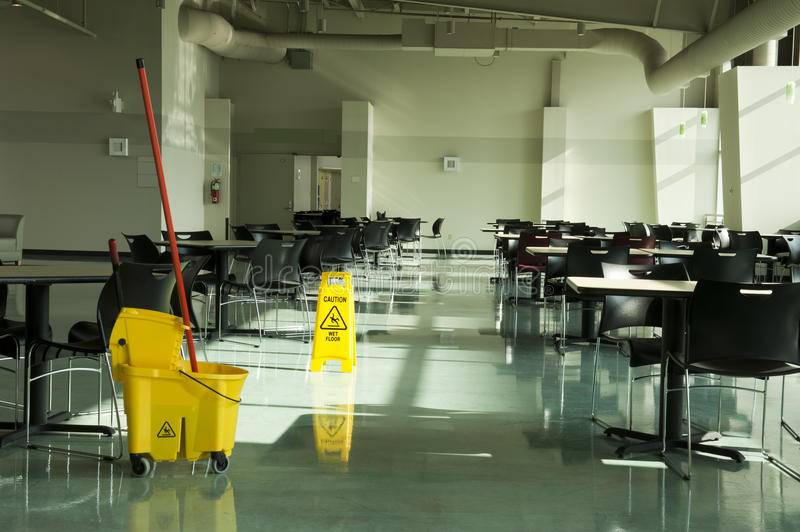 Mop bucket caution sign cafe tables royalty free stock images