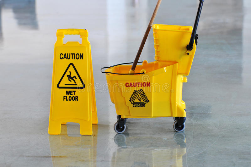 Mop, Bucket and Caution Wet Floor royalty free stock photos