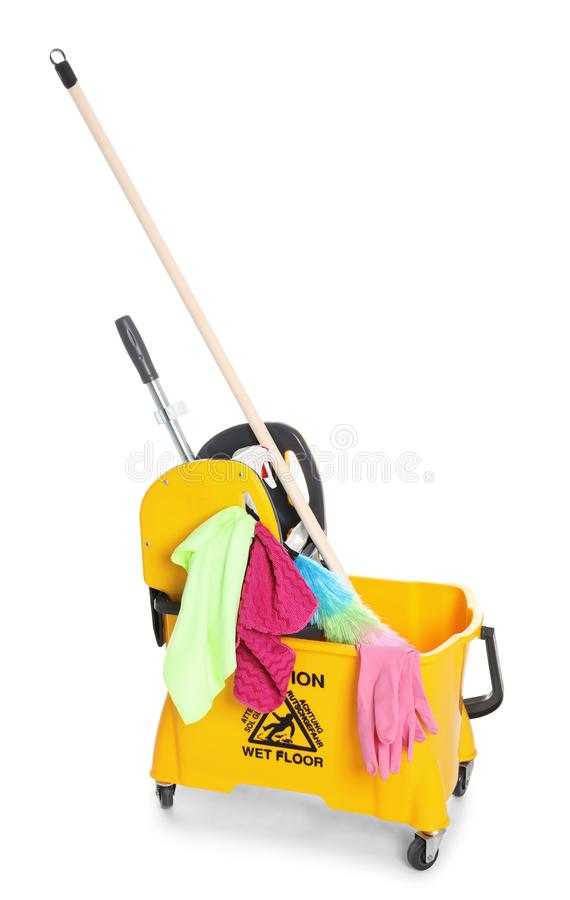 Mop bucket with cleaning supplies. On white background royalty free stock photography