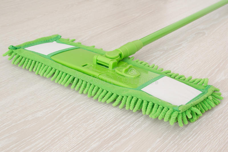 mop cleaning floors royalty free stock photo