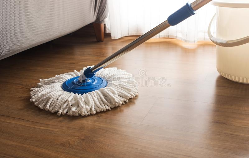 Mop cleaning on wooden floor royalty free stock photos