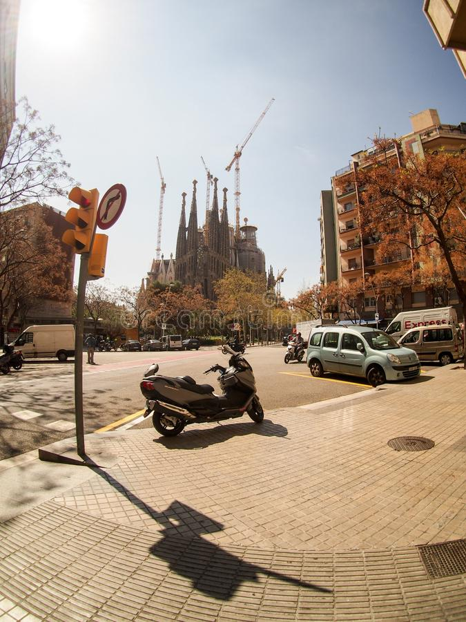 Moped Parked on Street Corner in Barcelona with Sagrada Familia stock photography