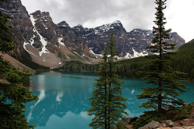 Moraine Lake. Scenic Moraine Lake in Banff National Park, Alberta, Canada, with turquoise blue waters and low clouds stock image