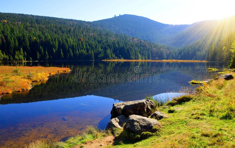 Moraine lake Kleiner Arbersee with mount Grosser Arber in National park Bavarian forest. royalty free stock photo