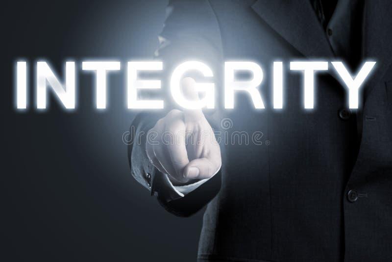 Moral do negócio ou éticas conceito, homem que aponta inte na palavra ' imagem de stock