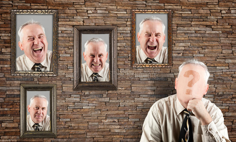 Morale concept. Man without a face thinking. Four portrait on the wall contains different expressions. Expressions concept