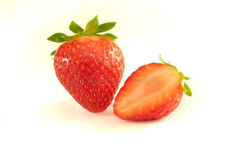 Morango e morango da metade no fundo branco fotografia de stock