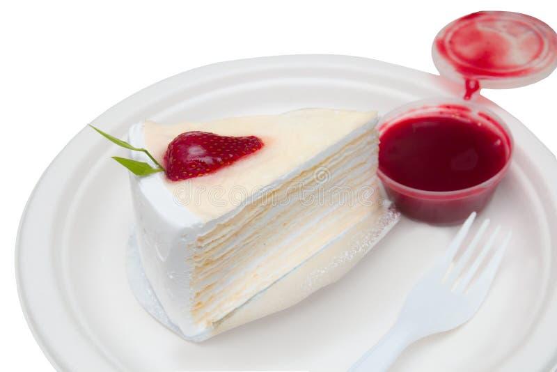 Morceau de boulangerie de gâteau de crêpe avec de la sauce à fraise photos stock
