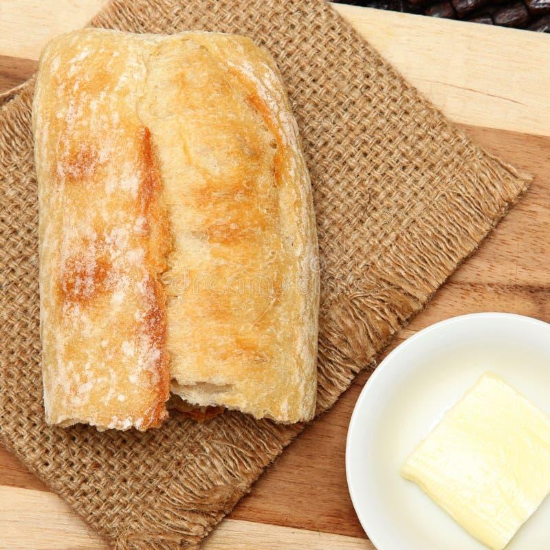 Morceau de pain de baguette images stock