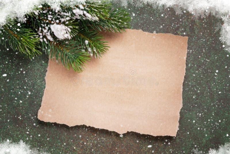 Morceau de papier pour des souhaits de Noël photographie stock libre de droits