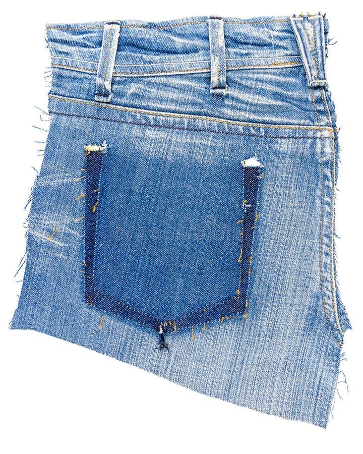 Morceau de tissu de blues-jean avec déchiré de la poche arrière images stock