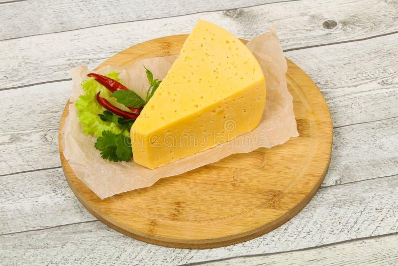 morceau du fromage jaune photographie stock