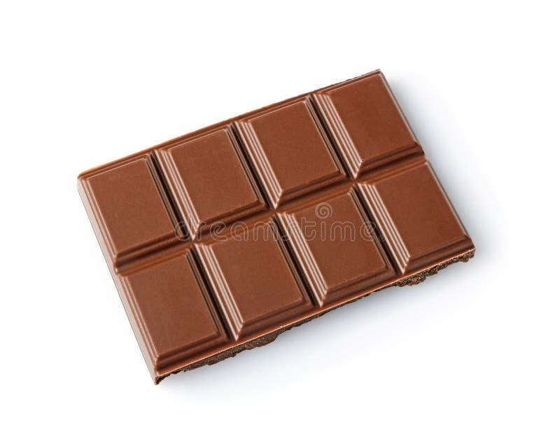 Morceau en gros plan de barre de chocolat au lait image stock