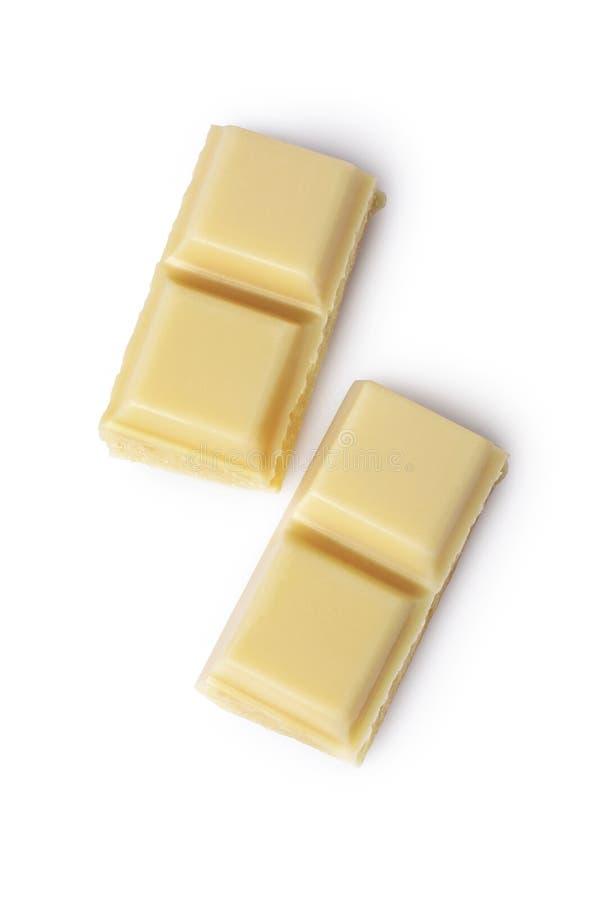 Morceau en gros plan de barre de chocolat blanche images stock