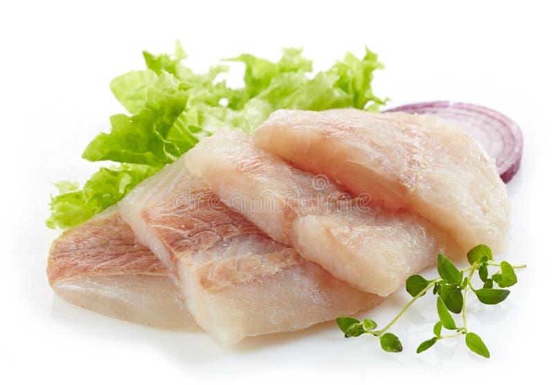 Morceaux crus de filet de poissons de merluches image libre de droits