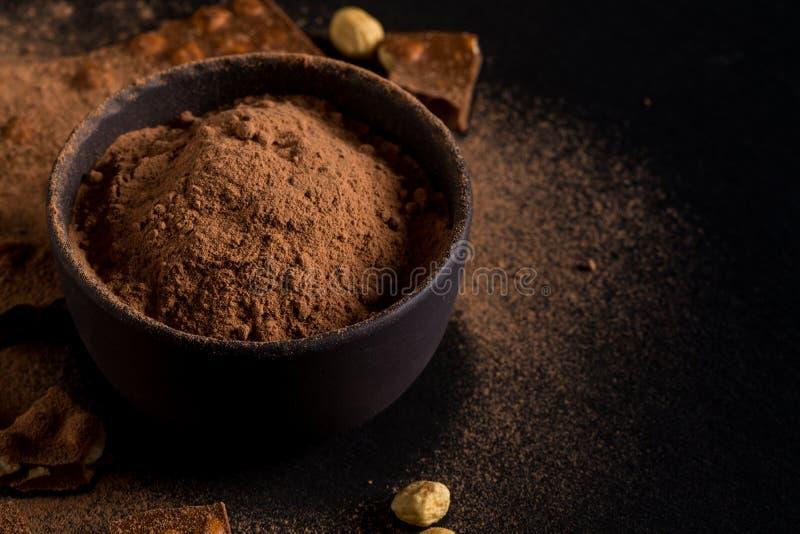 Morceaux d'écrous de chocolat de poudre d'ocoa de ¡ de Ð photos stock