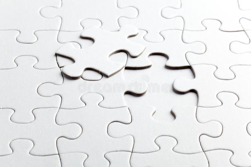 Morceaux de blanc de puzzle images stock