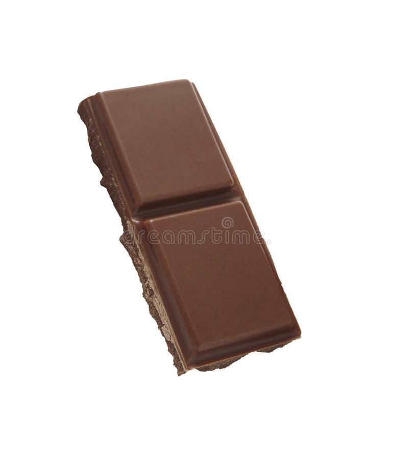 Morceaux de chocolat d'isolement sur le blanc image stock