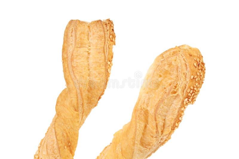 Morceaux de pâte feuilletée croquante avec le sésame. images stock