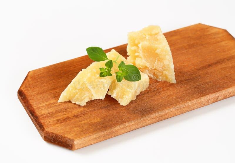 Morceaux de parmesan photographie stock
