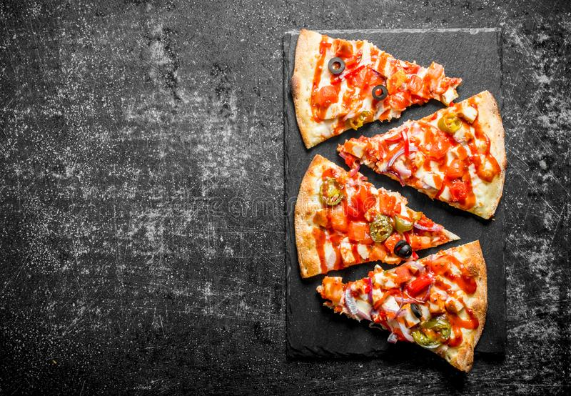 Morceaux de pizza mexicaine photographie stock libre de droits