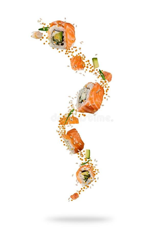 Morceaux de vol de sushi saumonés photo stock